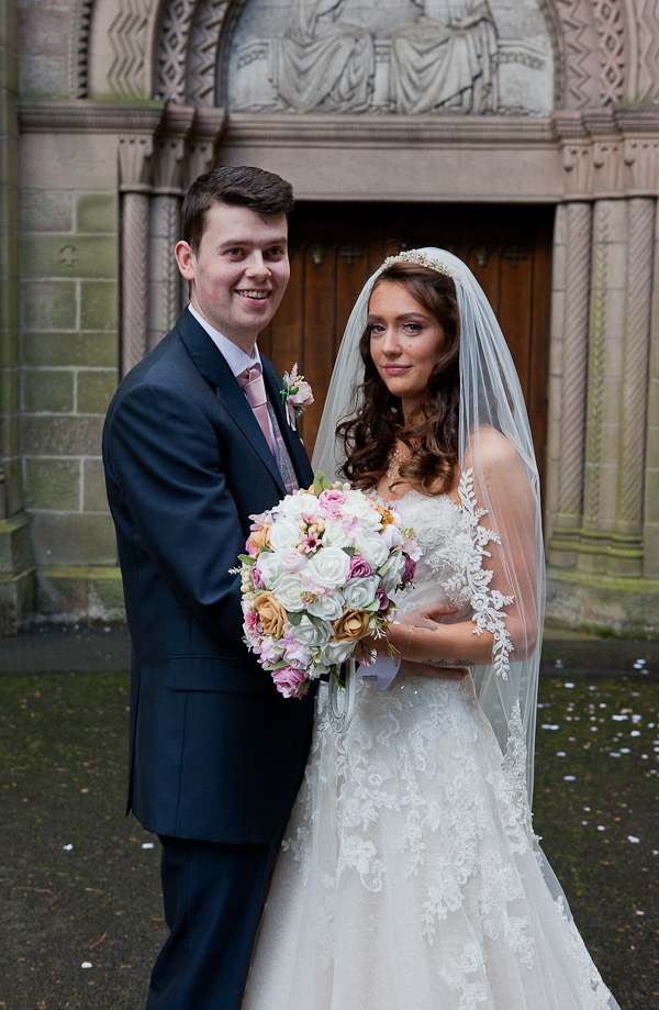 bride and groom at church manchester