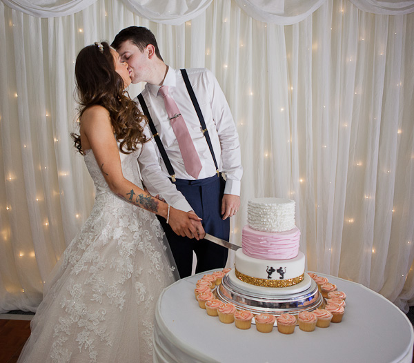cake cutting photograph at manchester wedding