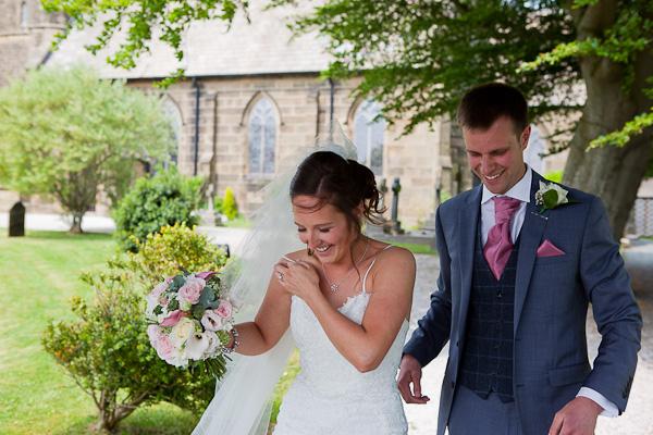 bride and groom at church wedding preston